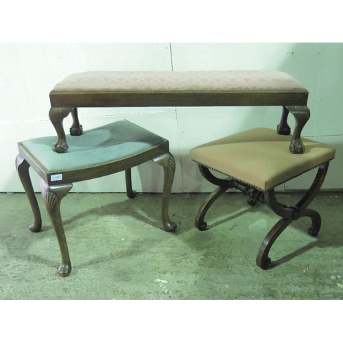 1121 - A late 19th century upholstered stool together with a long foot stool and another....