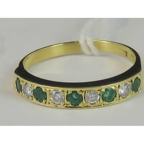 113 - An 18ct gold emerald and diamond half eternity ring, five round emeralds separated by four round dia...