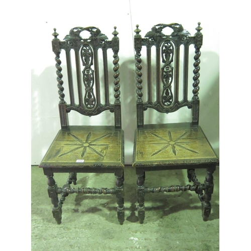 1152 - A pair of Victorian ebonised gothic style carved chairs with barley twist supports; a/f....