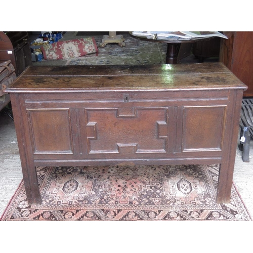 1160 - A late Georgian oak coffer with blind carved front panels; with internal compartment; 138cm wide....