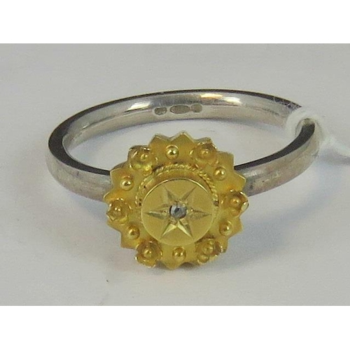 119 - A silver and yellow metal ring, yellow metal head set with diamond chip on a white metal shank hallm...