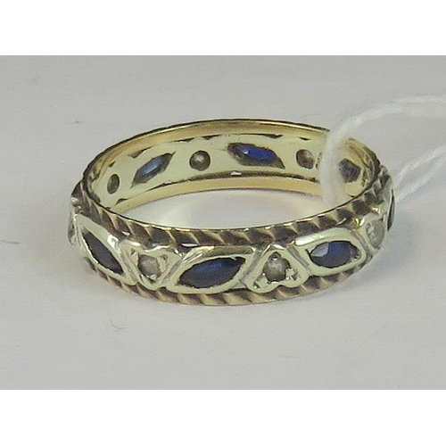 135 - A 9ct gold sapphire and white stone eternity ring, marquise cut sapphires alternating with round whi...