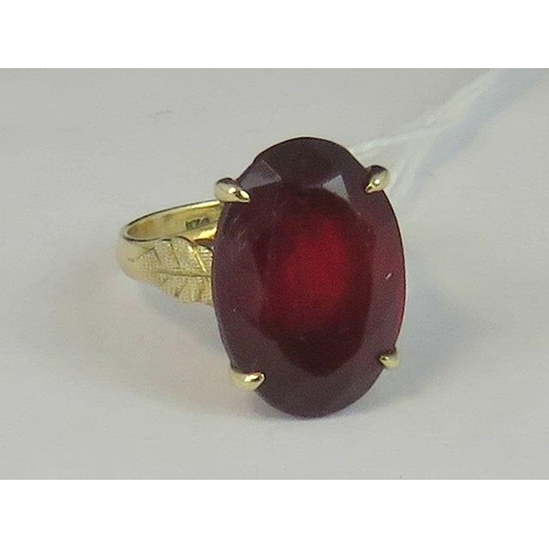 142 - A large and impressive 14ct gold garnet ring, oval garnet approx 9cts claw set in yellow metal with ...