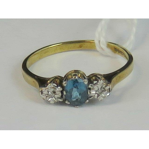144 - A 9ct gold topaz and diamond ring, central oval topaz approx 0.25ct flanked by a pair of illusion se...