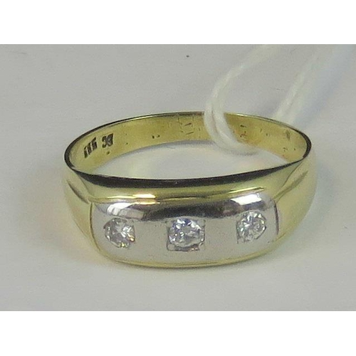 147 - A 14ct gold and diamond gypsy ring, central white metal panel set with three graduated diamonds appr...
