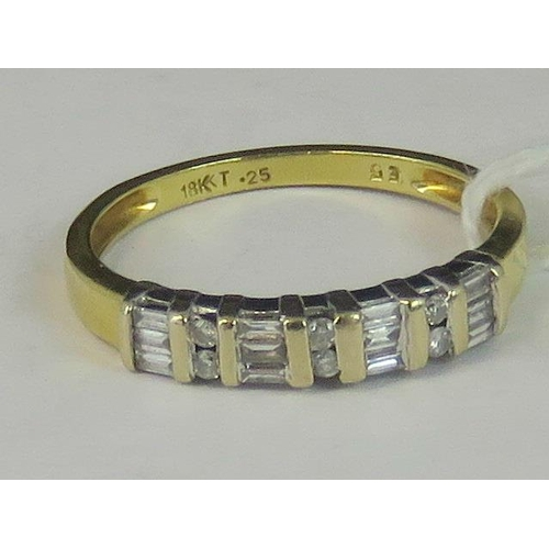 152 - An 18ct gold and diamond ring, four pairs of baguette cut diamonds separated by three pairs of round...