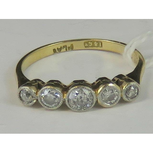 158 - An 18ct gold, platinum and diamond ring. Five graduated diamonds, 0.45cts total, set in white metal ...