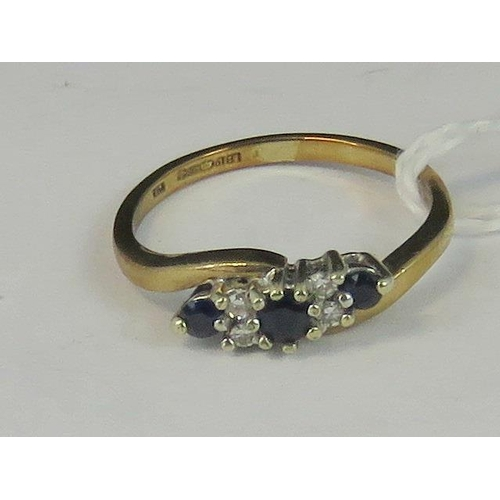 160 - A 9ct gold diamond and sapphire ring, three graduated round sapphires separated by two pairs of diam...
