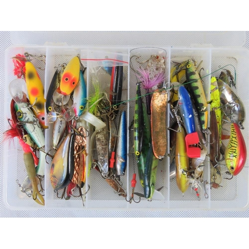 149 - Around sixty assorted spinners and plugs for Pike & Salmon in six-sectional box. From the personal c...