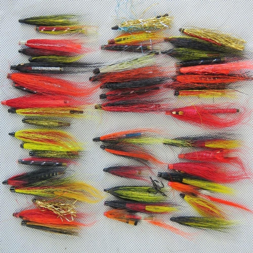 150 - Around fifty Salmon tube flies in a three-sectional box. As used by Bob Church for fishing large 20l...