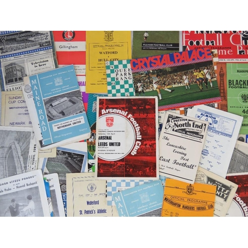 164 - Over 40 football programmes from 1950s - 1970s featuring Manchester City, Queens Park Rangers, Cryst...
