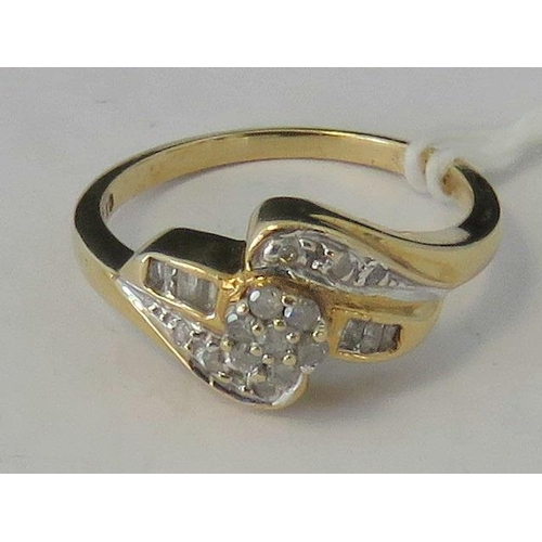 109 - A 10ct gold and diamond twist design ring, central diamond cluster with three baguette cut diamonds ...