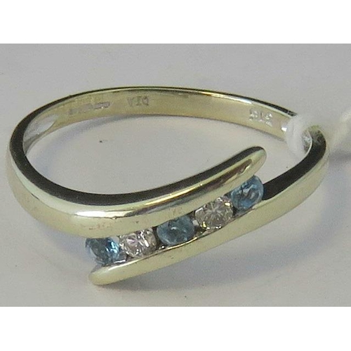 112 - A 9ct gold diamond and aquamarine twist style ring, three round cut aquamarines separated by two rou...