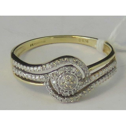 139 - A 9ct gold diamond encrusted twist design ring, two sets of three rows wrapping around a central clu...