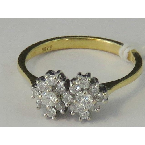 148 - An 18ct gold diamond double cluster ring, hallmarked 750, 2.89g. Size L-M....