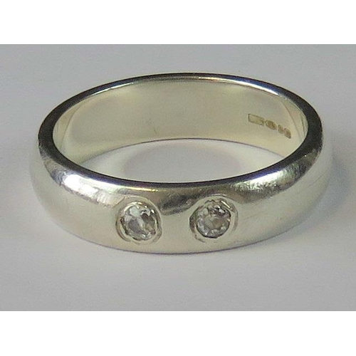 151 - A HM silver and diamond ring, two 0.06ct diamonds in rub over setting, wide silver band hallmarked B...