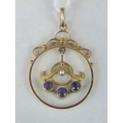 162 - A 9ct gold seed pearl and amethyst pendant, bale stamped 9c, 3.4cm long, 1.86g....