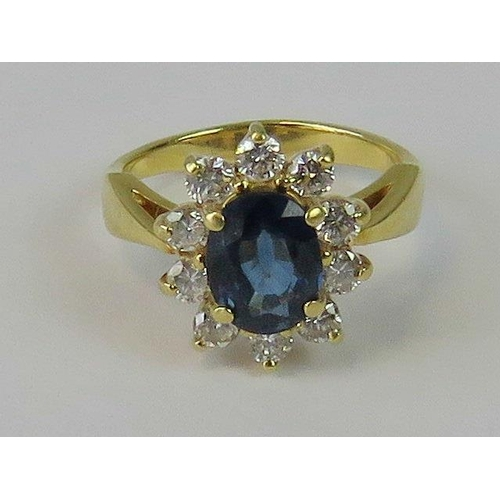 165 - A superb 18ct gold diamond and sapphire ring, central oval Ceylon blue sapphire approx 1ct, surround...
