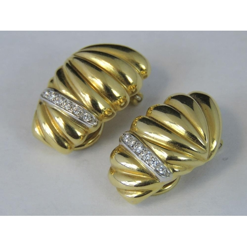 171 - A pair of 18ct gold and diamond clip on earrings, each earring set with row of diamond chips in whit...