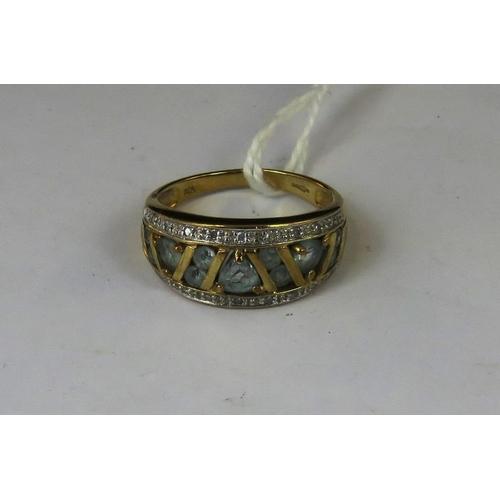 173 - A 9ct gold aquamarine and diamond ring, three triangular aquamarines separated by four pairs of roun...