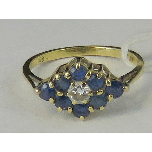 179 - An 18ct gold sapphire and diamond cluster ring, diamond shaped cluster of eight sapphires, central d...