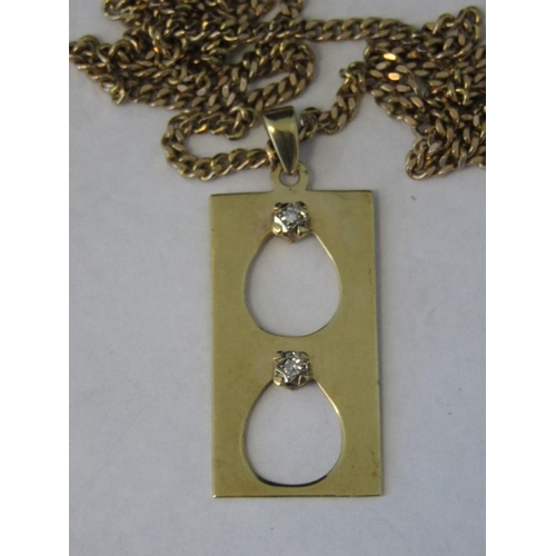 182 - A 9ct gold rectangular pendant set with two diamonds, on a 9ct gold heavy curb link chain, 41cm in l...