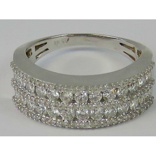185 - A 10ct white gold diamond encrusted half eternity band. Two rows of thirteen round cut diamonds, app...