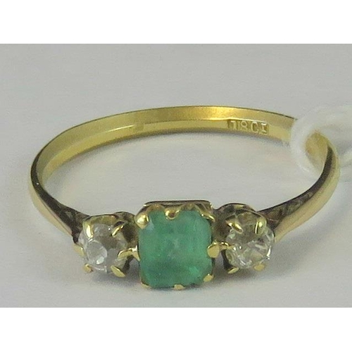 187 - An 18ct three stone emerald and diamond ring, central square emerald approx 0.45cts flanked by a pai...