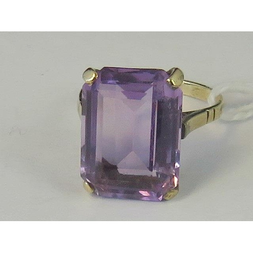 192 - An Art Deco 9ct gold amethyst ring, emerald cut amethyst approx 7cts claw set in yellow metal stampe...