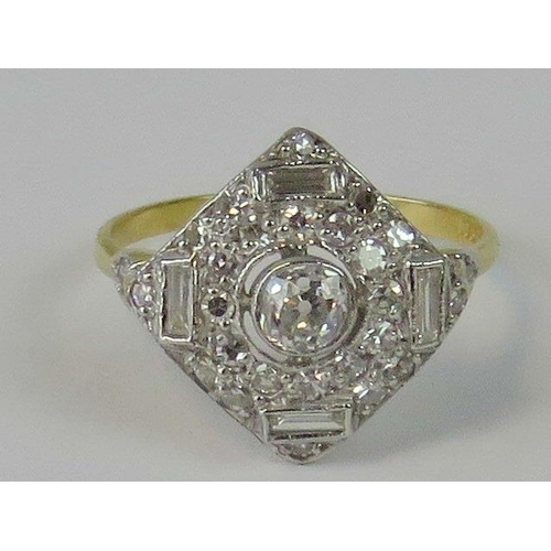 194 - An Art Deco style 18ct gold and diamond ring. Square head encrusted with diamonds, central oval diam...