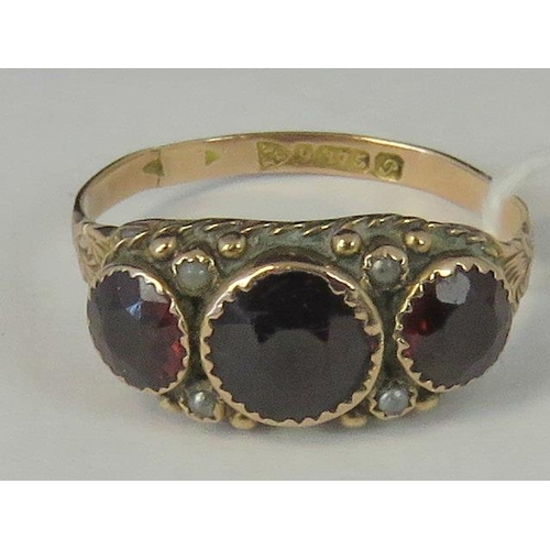196 - A high Victorian 9ct gold garnet and seed pearl ring, three graduated garnets separated by four seed...