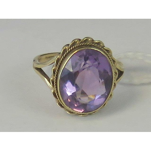 197 - A 9ct gold amethyst ring, large oval amethyst approx 4cts in twisted rope setting, shank hallmarked ...