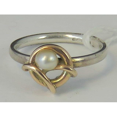 198 - A silver and yellow metal ring, single pearl on a yellow metal hoop and vine on a silver shank hallm...