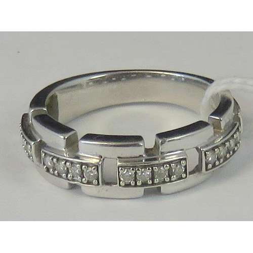200 - A mens 9ct white gold and diamond ring, box link effect with four 'links' each set with four diamond...