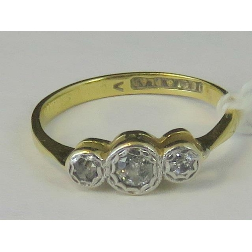201 - An 18ct and platinum three stone diamond ring. three diamonds approx 0.1ct set in white metal on a y...