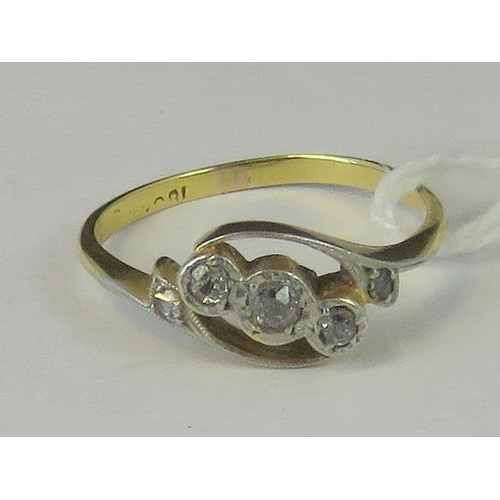 202 - An 18ct gold and diamond twist style ring, three diamonds in illusion settings within twist style mo...