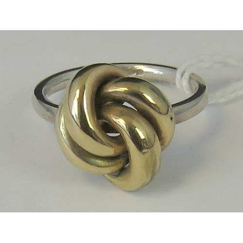 203 - A silver and yellow metal knot ring, shank hallmarked 925, size M, 3.04g...