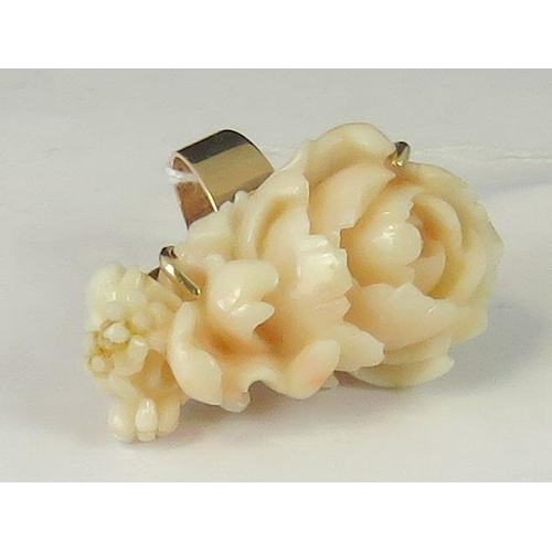 205 - A 14ct gold carved 'angel skin' coral ring, peony design approx 4.5cm long, set in yellow metal stam...