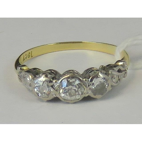 206 - An 18ct gold and platinum three stone diamond ring, the illusion set diamonds approx 0.35cts set in ...