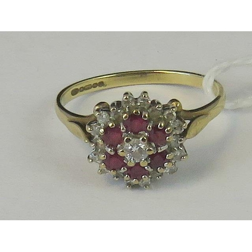 209 - A 9ct gold ruby and diamond three tier cluster ring, central diamond surrounded by a gallery of rubi...