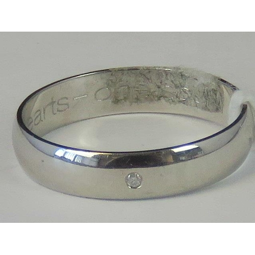 218 - A 9ct white gold and diamond band, diamond chip set in white metal hallmarked 375, size O, 2.09g...
