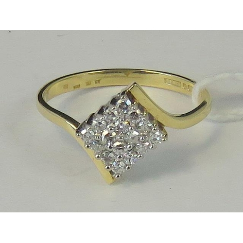 219 - An 18ct gold diamond cluster ring, square shaped cluster of sixteen diamonds set in white metal on a...