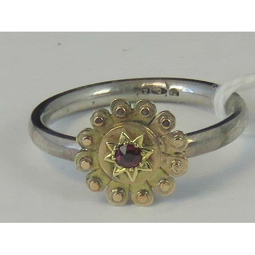 220 - A silver and yellow metal ring, yellow metal head set with ruby on a white metal shank hallmarked 92...