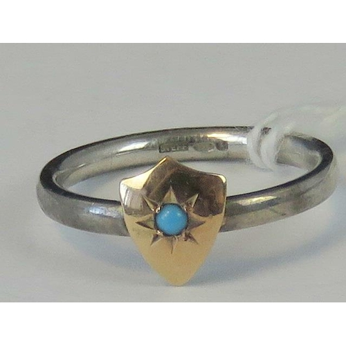 223 - A silver and yellow metal ring, yellow metal head set with turquoise on a white metal shank hallmark...