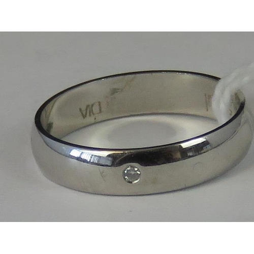 224 - A 9ct white gold and diamond band, diamond chip set in white metal hallmarked 375, size M, 2.24g...