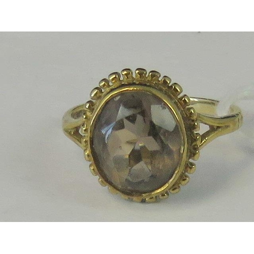 227 - A 9ct gold smoky quartz ring, oval quartz set in yellow metal hallmarked 375, size I, 2.4g...