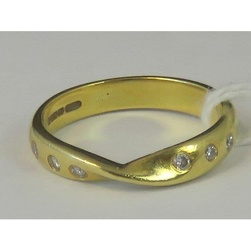 228 - An 18ct gold and diamond twist style band, six diamond chips set in yellow metal hallmarked 750, siz...