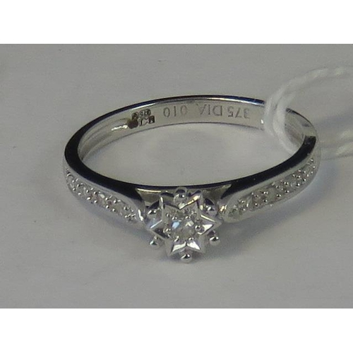 229 - A 9ct white gold and diamond ring, star shaped head set with single diamond, further four diamonds s...