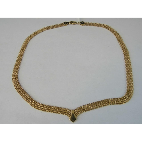231 - A 9ct necklace, four rows of interlining chain with plaque to centre, hallmarked 375, 42cm long, 6.9...