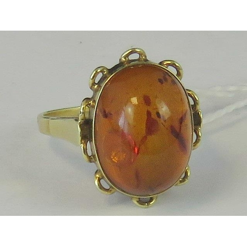 232 - A 14ct gold and amber ring, large amber cabachon set in yellow metal stamped 585, size N, 4.15g...
